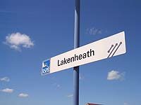 RSPB and National Express logos on station name signs at Lakenheath.  Picture: Chris Wood, 2003.